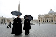 Priests in St Peter's Square at the Vatican after it was announced that Pope Benedict XVI will resign on February 11, 2013
