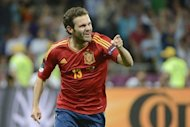 Spanish forward Juan Mata celebrates after scoring a goal during the Euro 2012 football championships final match Spain vs Italy at the Olympic Stadium in Kiev. Spain confirmed their status as one of the greatest national teams in football history by overwhelming Italy 4-0 in Sunday's Euro 2012 final in Kiev to retain their European crown