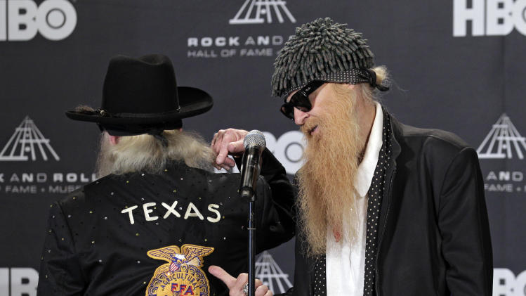 Billy Gibbons, left, and Dusty Hill of ZZ-Top appear in the press room after introducing the late Freddie King for induction into the Rock and Roll Hall of Fame Friday, April 13, 2012, in Cleveland. (AP Photo/Amy Sancetta)