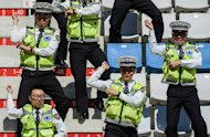 South Korean police do a 'Gangnam Style' dance at the Formula One Korean Grand Prix in Yeongam in October. While Psy was taking the headlines in 2012, Korean electronics giant Samsung saw its share of the smartphone market surge to 31.3% in the third quarter, up from just 3.3% in late 2009