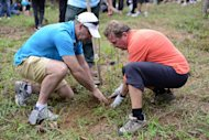 Dr. Gerhard Pils and Mr. Joe Hall planting their first Dryobalanops aromatica Kapur tree at the Kepong FRIM Botanical Garden.