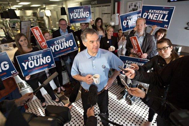 Alberta Conservative leader Jim Prentice speaks with media after meeting with supporters on a visit to the Italian Centre during a campaign stop in Edmonton, Alta., on Monday, May 4, 2015. THE CANADIAN PRESS/Jason Franson