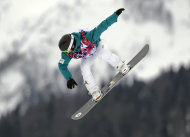 Australia's Torah Bright takes a jump in her first run in the women's snowboard slopestyle final at the 2014 Winter Olympics, Sunday, Feb. 9, 2014, in Krasnaya Polyana, Russia. (AP Photo/Andy Wong)