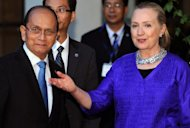 US Secretary of State Hillary Clinton welcomes Myanmar President Thein Sein before a meeting in Siem Reap, on July 13. Clinton flew out of Asia on Saturday after a trip dominated by significantly warmer ties with Myanmar as Washington looks to open the resource-rich former pariah to US firms