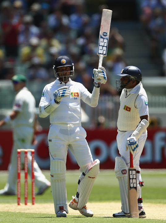 MELBOURNE, AUSTRALIA - DECEMBER 26: Kumar Sangakkara of Sri Lanka raises his bat after reaching tenthousand career runs during day one of the Second Test match between Australia and Sri Lanka at Melbo