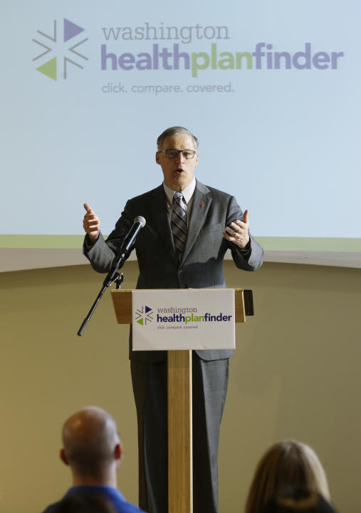 Washington Gov. Jay Inslee speaks at an event Wednesday, April 23, 2014 in Seattle to highlight the success of the Washington state healthcare exchange in getting hundreds of thousands of people into