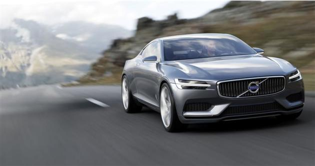 An handout shows a Volvo Concept Coupe being driven on a road in a mountainous area