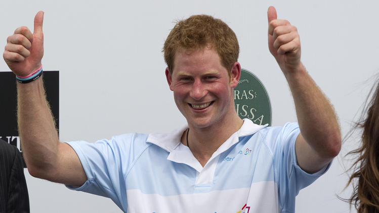 FILE - In this Sunday March 11, 2012 file photo Britain's Prince Harry gives a thumbs up during the award ceremony after playing a charity polo match in Campinas, Brazil. St. James's Palace say Monday March 25, 2013, Prince Harry is returning to the United States — but this time he's skipping Las Vegas. (AP Photo/Andre Penner, File)