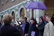 "Female members of the clergy and visitors pose outside the venue of the Church of England General Synod in central London on November 20. The Church of England has ""undoubtedly"" lost credibility after voting to reject the appointment of women bishops, its leader the Archbishop of Canterbury said Wednesday."