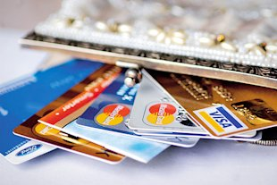 It's particularly important to have a credit card in your name to help establish your own credit profile.