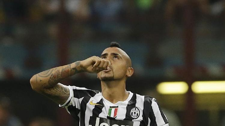 Juventus midfielder Arturo Vidal, of Chile, celebrates after scoring during a Serie A soccer match between Inter Milan and Juventus, at the San Siro stadium in Milan, Italy, Saturday, Sept. 14, 2013