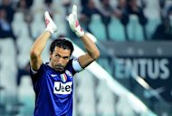 Juventus' goalkeeper Gianluigi Buffon acknowledges the audience during the Serie A football match between Juventus and Chievo Verona at the Stadio delle Alpi in Turin, on September 22. Serie A champions Juventus pulled ahead of the rest of the pack with a 2-0 win over Chievo as their closest challengers slipped up on a dramatic fourth round of matches Sunday
