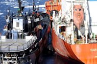 This handout picture taken by Japan's Institute of Cetacean Research (ICR) on February 20, 2013 shows the environmental group's ship Sea Shepherd (L) steering its bow between an oil supply ship (R) and Japan's whaling ship Nisshin Maru (not pictured), in the Southern Ocean. Japan vowed to continue its whale hunt after the clashes