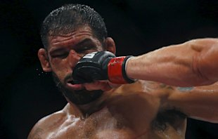 Minotauro Nogueira (L) of Brazil receives a punch during a fight against Stefan Struve. (Reuters)