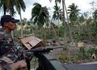 Philippine soldiers look for survivors in New Bataan town on December 5, 2012. The Philippine military on Sunday began a holiday season truce against communist insurgents after the rebels called their own limited ceasefire in typhoon-hit regions, a spokesman said