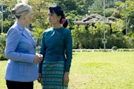 This file photo shows Myanmar's pro-democracy opposition leader Aung San Suu Kyi (R) and US Secretary of State Hillary Clinton during their meeting at Suu Kyi's residence in Yangon, last December