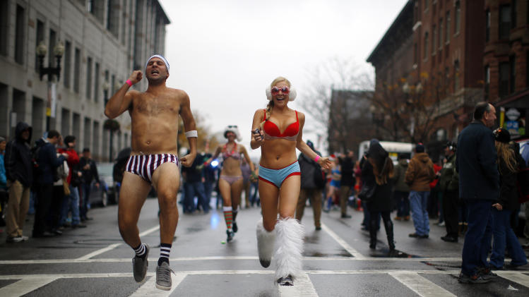 "Participants in the annual ""Santa Speedo Run"" leave the starting line in Boston"