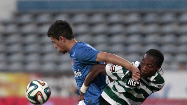 Sporting's Carlos Mane fights for the ball with Belenenses' Andre Geraldes during their Portuguese Premier League soccer match at Restelo stadium in Lisbon