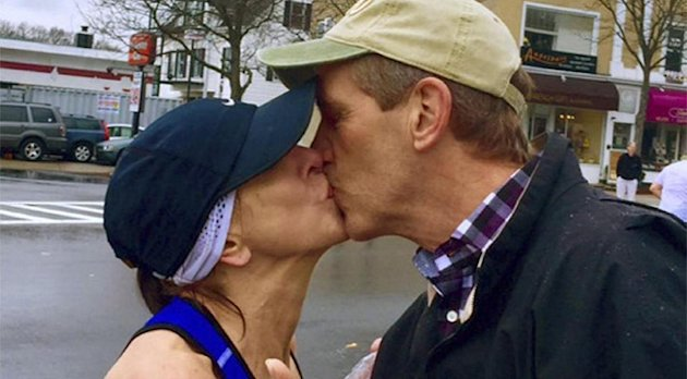 Barbara Tatge, left, kisses an unknown spectator as she ran in the Boston Marathon.