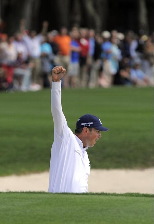 Matt Kuchar celebrates after sinking a birdie putt from the bunker on the 18th green to win the final round of the RBC Heritage golf tournament in Hilton Head Island, S.C., Sunday, April 20, 2014. Kuc