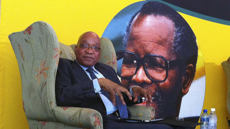 South African president Jacob Zuma, in front of a portrait of former African National Congress president Oliver Tambo, addresses foreign correspondents at a breakfast in Johannesburg, Monday, Oct. 29, 2012.  Zuma said that the freedom of expression needs to be balanced to the right to dignity and privacy to all South Africans after he agreed to withdraw a defamation case against a newspaper cartoonist who depicted him poised to rape Lady Justice. (AP Photo/Andrew Meldrum)