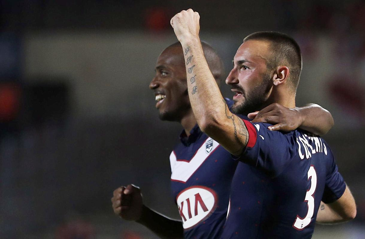 Diego Contento of Girondins Bordeaux celebrates with his team mate Nicolas Maurice Belay during their French Ligue 1 soccer match against Monaco in...