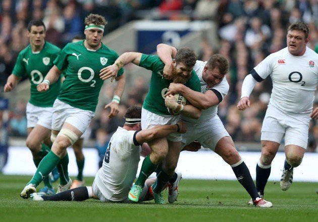 Gordon D'Arcy tackled by Dylan Hartley