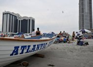 Nik Wallenda, the American man who recently walked across a wire strung over Niagara Falls, hit the Atlantic City beach for a stroll Thursday -- 100 feet above the beach, to be exact