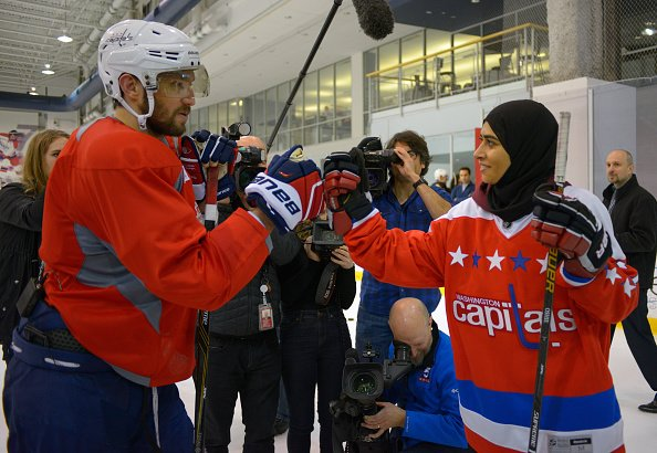 ARLINGTON VA, FEBRUARY 8: United Arab Emirates native Fatima Al Ali, right, bumps gloves with Capitals Alex Ovechkin after practice. She's a young female hockey player who showed incredible stick handling skills at a clinic in UAE, which went viral.The Washington Capitals hosted Al Ali to mix with the team near the end of practice at the Capitals practice facility in Arlington VA, February 8, 2017. (Photo by John McDonnell / The Washington Post via Getty Images)