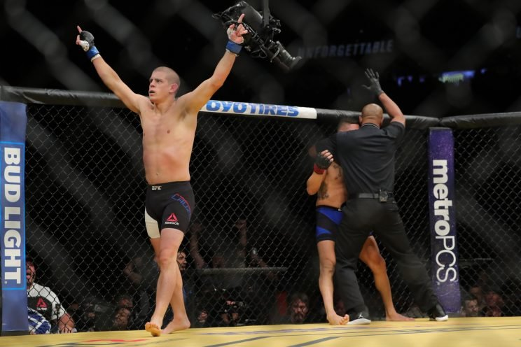 Joe Lauzon celebrates after knocking out Diego Sanchez. (Getty)