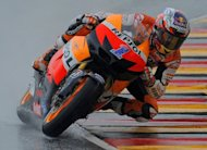 Australia's Casey Stoner of the Repsol Honda team competes in the qualifying session at the Sachsenring Circuit in Hohenstein-Ernstthal, eastern Germany. Stoner will start Sunday's German motorcycling Grand Prix on pole position after topping Saturday's wet qualifying session at the Sachsenring