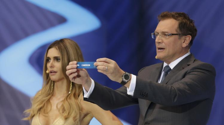 "Valcke holds up the slip showing ""Cameroon"" during the draw for the 2014 World Cup in Sao Joao da Mata"