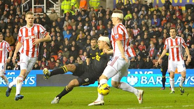 Wigan Athletic's Franco Di Santo gets to the ball before Stoke City's Robert Huth to score their second goal (PA Sport)