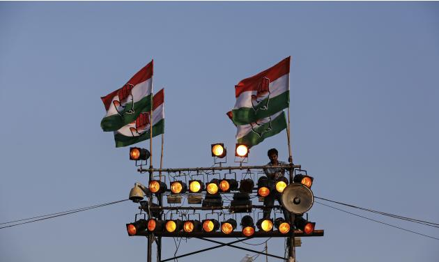 A worker checks the lights during election campaign rally of India's ruling Congress party in Mumbai