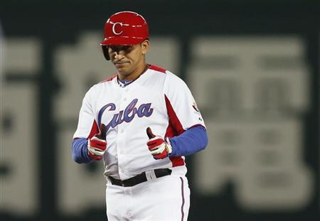 Cuba's Cepeda reacts after hitting an RBI double against Japan in the fourth inning at the WBC qualifying first round in Fukuoka