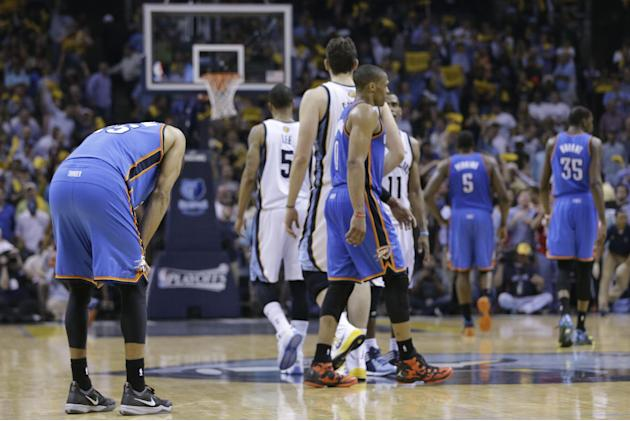 Oklahoma City Thunder guard Thabo Sefolosha, left, pauses on the court after the Memphis Grizzlies drew a foul in overtime of Game 3 of an opening-round NBA basketball playoff series Thursday, April 2