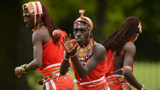 A Maasai cricket warrior catches a ball before match against English team 'The Shed' during the Last Man Stands tournament in London