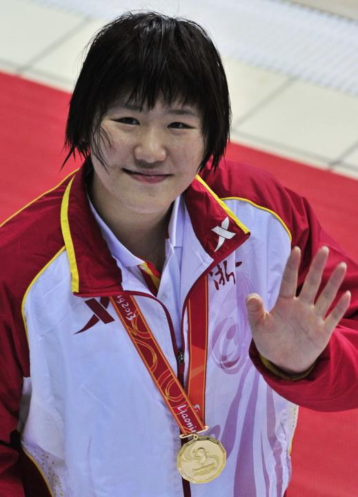 Ye Shiwen of Zhejiang province, waves after winning the women's 200m individual medley final at the 12th Chinese National Games, in Shenyang