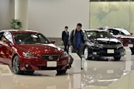 A customer inspects Toyota's Lexus brand vehicles at Toyots'a showroom in Tokyo, 2011. Japanese automobile sales saw their biggest-ever monthly surge in March, data showed, a year after domestic demand plummeted in the wake of the country's quake-tsunami disaster