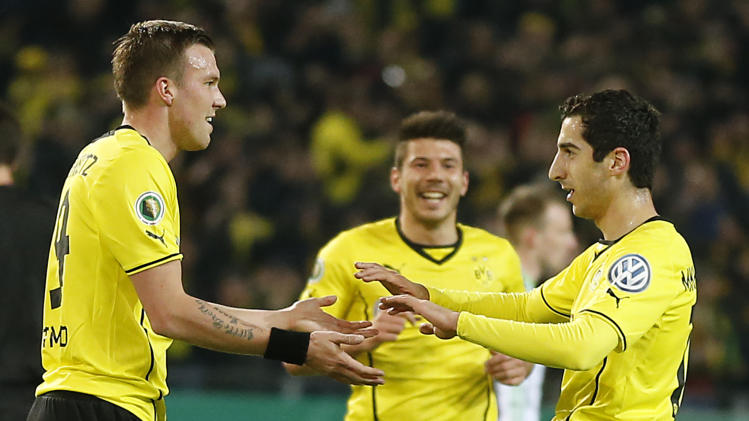 Dortmund's Henrikh Mkhitaryan of Armenia, right, celebrates with Dortmund's Kevin Grosskreutz, left, and Dortmund's Milos Jojic of Serbia after scoring during the German soccer cup (DFB Pokal) semifinal match between BvB Borussia Dortmund and VfL Wolfsburg Tuesday, April 15, 2014 in Dortmund, Germany