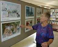 Misako Katani displays a painting illustrating the horror of nuclear bombings in Hiroshima's city hall on August 1, 2010. Katani said that images of the Fukushima nuclear crisis reminded her of the horror of living through both atomic bombings of Japan