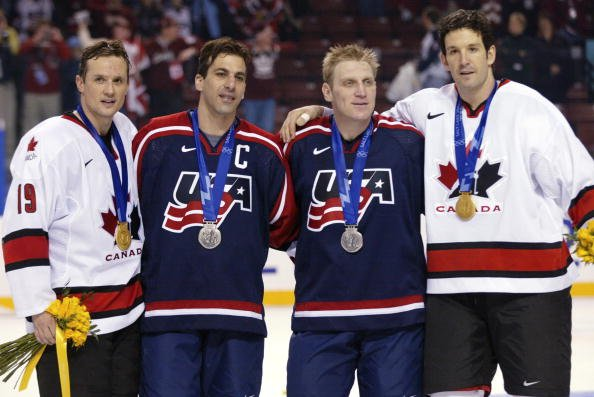 24 Feb 2002: (L-R) Steve Yzerman #19 of Canada, Chris Chelios #24 of the USA, Brett Hull #16 of the USA and Brendan Shanahan #14 of Canada pose with their medals after the mens ice hockey gold medal game of the Salt Lake City Winter Olympic Games at the E Center in Salt Lake City, Utah. They all play together in NHL with the Detroit Red Wings . DIGITAL IMAGE. Mandatory Credit: Jamie Squire/Getty Images