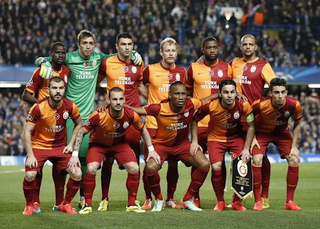 Members of the Galatasaray team gather before the start of a UEFA Champions League football match between Chelsea and Galatasaray in London, on March 18, 2014