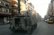 Lebanese army troops patrol the streets of Tripoli's Sunni Muslim neighbourhood of Bab al-Tabbaneh as fresh sectarian clashes erupted between pro- and anti-Syrian districts in the northern Lebanese port city