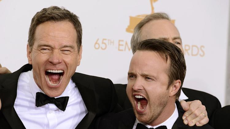 "Bryan Cranston, left, and Aaron Paul, winners of the best drama series award for ""Breaking Bad"" pose backstage at the 65th Primetime Emmy Awards at Nokia Theatre on Sunday Sept. 22, 2013, in Los Angeles. (Photo by Dan Steinberg/Invision/AP)"