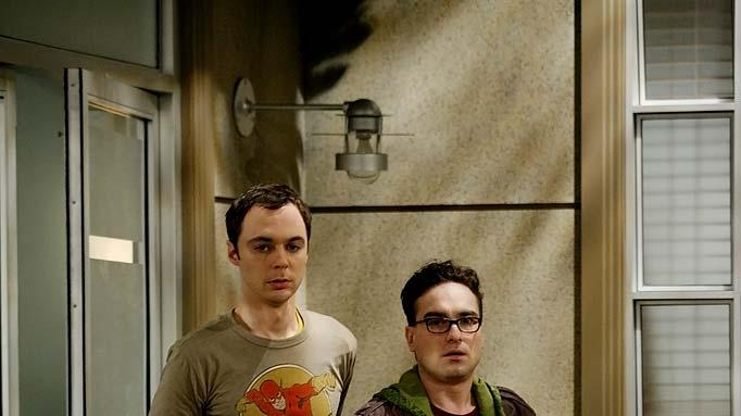 When Leonard (Johnny Galecki, right) and Sheldon (Jim Parsons, left) meet new neighbor Penny, Leonard is excited, but Sheldon is less enthusiastic for he feels his friend is only chasing a dream he'll never catch, on The Big Bang Theory.