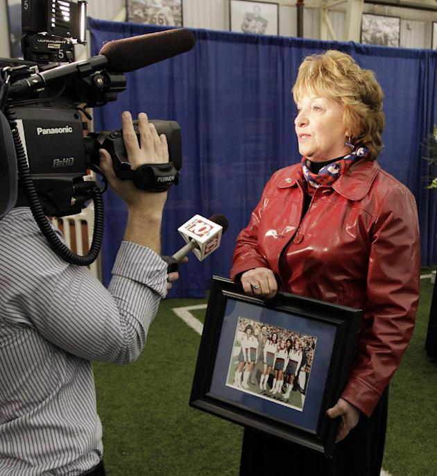 Kathleen Hubbard a former Buffalo Bills cheerleader, answers questions from the media during a public memorial and remembrance being held inside the NFL football team's fieldhouse for Buffalo Bill