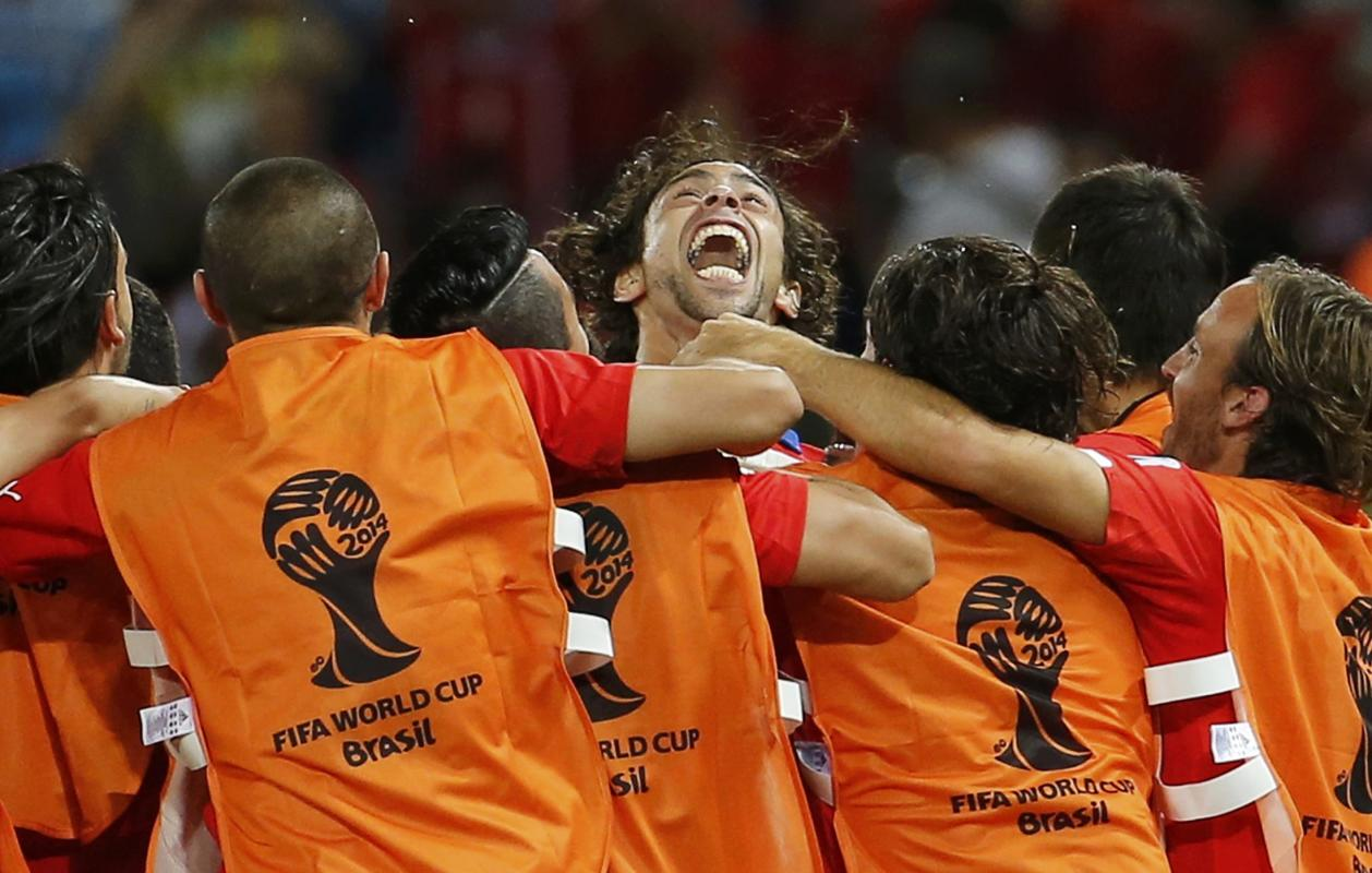Chile's Valdivia celebrates his goal against Australia with his teammates during their 2014 World Cup Group B soccer match at the Pantanal arena...
