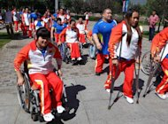 Chinese athletes prepare to depart for the London Paralympics 2012, in Beijing, August 21, 2012. China's new generation of athletes arrived in London with hopes of dominating the Paralympics, but officials are downplaying chances the streamlined team can match its mammoth 2008 medal haul