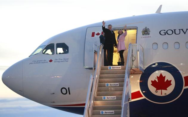 Canada's PM Harper and wife Laureen board the Royal Canadian Air Force Airbus CC-150 Polaris for a trip to Johannesburg, in Ottawa
